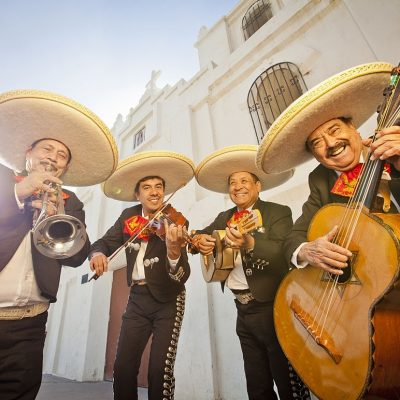 Group of four Musicians playing Mariachi music